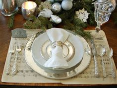 Stunning silver cutlery and balls are decking up this Christmas table