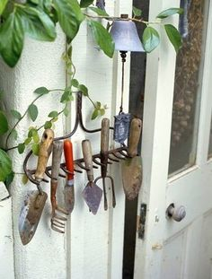 hand tools displayed on old rake. I wonder if I can find one of these at a yard sale?