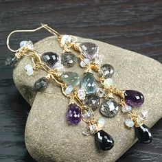 We all have that friend or family member that's impossible to shop for. Even the most indecisive loved one is sure to fall in love with these stunning dangle earrings. I use a hammered 14K gold-filled oval link chain to hang amethyst, amethyst, moss aquamarine, black rutilated quartz,