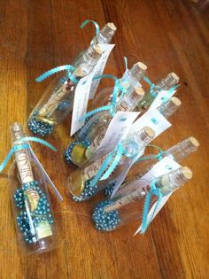 DIY invites to the Pirate Princess Party! Message in a bottle craft bottles, beads and chocolate gold coins from OrientalTrading.com, treasure map invites from Shindigz.com