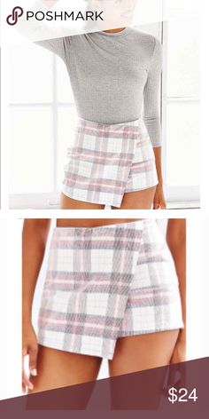 NEW Silence + Noise plaid asymmetrical skort Urban Outfitters Silence + Noise Asymmetrical Skort. Size 4. Minimally chic skort from fashion-forward brand Silence + Noise. Super short + fitted silhouette featuring an asymmetrical draped front. Plaid print on light corduroy fabric perfect for fall and holiday outfits. Urban Outfitters Skirts Asymmetrical