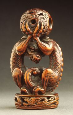 Netsuke in form of a dragon seal - 18th century netsuke. Wood. LACMA Collections.