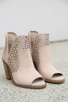 """Slits at the sides and eye-catching geometric cutouts update a classic open-toe bootie lifted by a stacked heel. - Vanilla Cream in color - 3 1/2"""" heel (size 8.5) - 4"""" shaft - Slip-on style - Leather"""