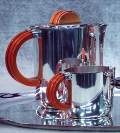 Art Deco coffee pot set restoration.  Art Deco design of the 1930's came from the Bauhaus, the famous art school and movement of Twentieth Century Germany. Hitler closed the Bauhaus, but many of the artists, craftsmen, and designers continued to work in Germany.  This accounts for the powerful influence of German design even as the Third Reich was killing and persecuting these artists.