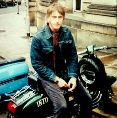 Paul Weller on Lambretta, he has a great smile but always seemed too cool to ever dot that