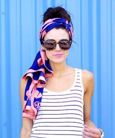 Go Bold I love the way this fashion blogger punched up a simple striped maxi dress with a neon handbag and boldly patterned Tory Burch headscarf. When you're wearing a quick no-fuss hairstyle, keep your makeup simple but impactful with a bright lip or a swipe of colored eyeliner.  To tie this headscarf simply follow the instructions here, but let the ends trail below your ponytail or bun.:
