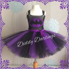 Purple and Black Batman Tutu Dress. Purple Batman. Purple Batgirl Tutu Dress. Beautiful & lovingly handmade. All characters and colours available Price varies on size, starting from £25. Please message us for more info. Find us on Facebook www.facebook.com/DiddyDarlings1 or our website www.diddydarlings.co.uk