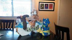 Monkeys and lions and giraffes diaper bike cake