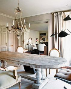 i want to refinish my farmhouse table to look like this. and it wouldn't hurt to have that gorgeous chandelier.