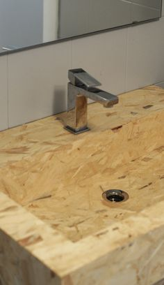 The challenge of domECO designers was to push the boundary of OSB everyday application and create a sink made out exclusively of chipboard panel.