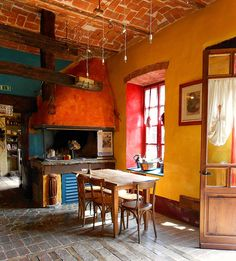 interior italian farmhouse. Too bright for my taste, but man! Look at this great happy place!