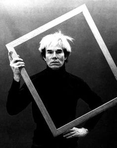 Andy Warhol holding a frame