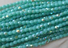 Fifty 3mm Opaque Turquoise AB Czech glass, firepolished, faceted round beads, C4550