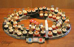 http://www.flickr.com/photos/glorioustreats/4043603535/  Cars Cupcake Display Idea