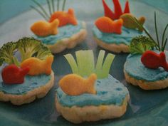 Rice Cakes, Blue Cream Cheese, Fishy Crackers  Veggies.  Cute Snack.