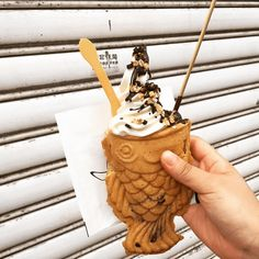 """""""Aboong"""" is a fish-shaped waffle with a delicious creamy filling like red bean paste or custard, topped off with the works -- frozen yogurt, chocolate syrup, and crunchy flakes."""