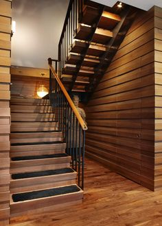 See the hidden doorway to the right of these stairs? It leads to the home's elevator.