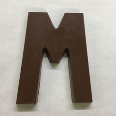 The letter M made of milk chocolate.