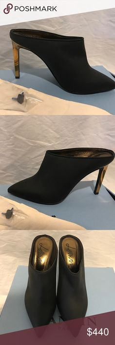 LANVIN AMAZING BLACK AND GOLD HEELS $950 retail LANVIN stunning soft leather heels.  Size 38.5 Right shoe looks to have retail wear from trying on.  Left shoe is spotless and after one wear you'll never know.  Comes with box, 2 dust bags and extra heel tips. Lanvin Shoes Heels