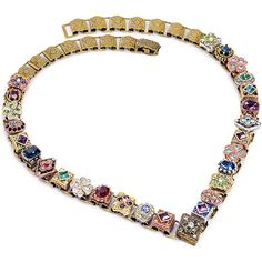 Sweet Romance Pewter Canterbury Victorian Box Chain Necklace This Sweet Romance V shaped necklace reminds us the design of Renaissance era collar-piece or carcanet that was revived in the Victorian era. Miniature emblems that are mixed of gold silver and bronze are set in a palette of regal color crystal cabochon cut stones and seed pearls. Each is mounted on a bronze finish book chain that has been produced from old dies of the late 1800s. The Sweet Romance Victorian style necklace is…