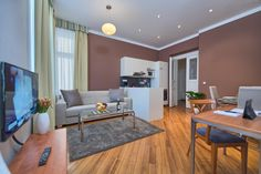 Supercute living are of a studio apartment in Residence Masna, two blocks from the Old Town Square! Fold Out Couch, Neutral Colors, Colours, Old Town Square, Apartment Interior Design, Lounge Areas, Best Location, Studio Apartment, Rental Apartments