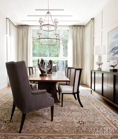 A tray ceiling designed by Castro and Belding adds architectural interest to the dining room. A chandelier from Circa Lighting hangs above the homeowner's Stickley table. Montresor buffet and Chinon chairs by Jiun Ho, available through R Hughes. Malayer Persian rug, Sullivan Fine Rugs. Quartz crystal by Ron Dier, available through Jerry Pair & Associates.