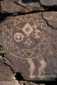 "A petroglyph of a headless ""shield man"" represents a mysterious link to the Anasazi people who left it behind in the Galesteo River Basin near the village of Galesteo, New Mexico  Photo by Charles Mann"