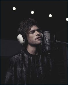 Taking to the studio, Vance Joy wears a bomber and tee by Emporio Armani.