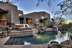 This luxury Arizona desert home combines waterscaping, xeriscaping and desertscaping to create a sustainable outdoor environment. It all starts with the rock water garden and waterfall at the front door. Minimalist House Design, Minimalist Decor, Modern House Design, Arizona Houses For Sale, House Front Design, Desert Homes, Vacation Home Rentals, California, Prefab Homes