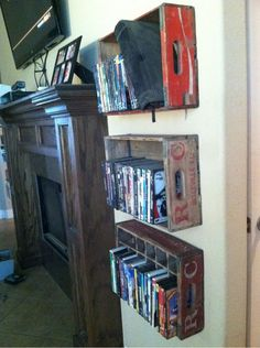 Attache these vintage soda crates to the wall on either side of the fireplace for DVD storage. http://hative.com/creative-diy-cd-and-dvd-storage-ideas-or-solutions/