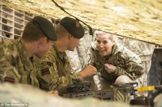 What's going on? Sophie chats to a pair of soldiers sitting under a stretch of camouflage ...