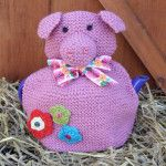 Pig Tea Cosy Large from jollynicegifts.com. Hand knitted and finished with crocheted flowers, pretty buttons and a neck ribbon. #weddinggift #mothersday #teacosy