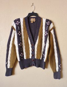 A personal favorite from my Etsy shop https://www.etsy.com/listing/115268915/vintage-hand-knitted-striped-cardigan