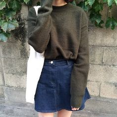 Denim A-line skirt and pullover sweater.                              …