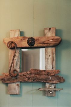 Eco art, mirror made out of old beach wood.