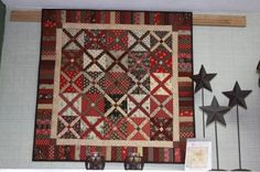 Hot Cross, CW repro fabrics in red, tan, and brown.