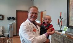 Baby Asher visits the NEDC, and makes an unsuccessful bid for Dr. Keenan's necktie.