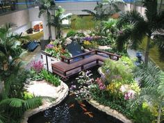 Lobby featuring an indoor Koi pond with gardens