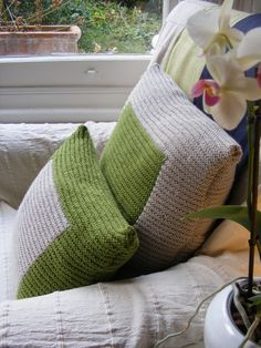 colourblock, cushion, knitting. Baby boy nursery decoration.