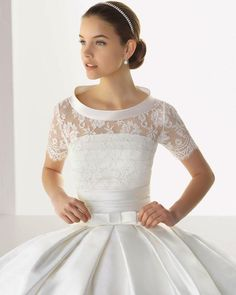 Like the top.  Loose the bow and slenderize the skirt.  Top comes off to reveal a strapless bodice.  Nice.  by Rosa Clara