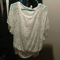 White Lacey blouse White lace over a built in Cami, flowing sleeves with a rouched gathered band at hip line. love J Tops Blouses