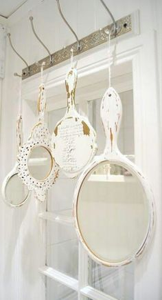 Hand mirrors --- Over the window.