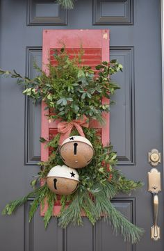 Christmas Bells & Greenery on an Old Shutter...would also be cute with a small wreath attached