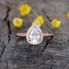 1.25 Carat Vienna Pear Shaped Moissanite Engagement Ring Halo | BBBGEM Rose Gold Engagement, Halo Engagement Rings, Halo Rings, Thing 1, Man Made Diamonds, White Gold Wedding Rings, Conflict Free Diamonds, Moissanite, Pear Shaped