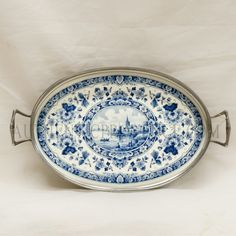 I love my Delft platter, I use it as a coaster and holder by the couch. Cheery and beautiful!