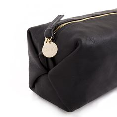 Clare V. has reimagined the classic dopp kit with black velvet leather and ripstop detailing for convenience and durability. Made either with soft, buttery leat
