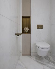 Inspiration for an elegant white decor for a guest bathroom or powder room. Design and photo:Sophie Paterson Interiors