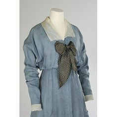 This simple 'seaside' dress formed part of Miss Heather Firbank's wardrobe. She was daughter of the affluent Member of Parliament Sir Thomas Firbank and sister of the novelist Ronald Firbank. The dress has a simple collar and spotted cravat. Its fresh youthful style conjures up images of summer holidays during the years before the First World War (1914-1918).  V Museum