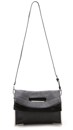 3.1 Phillip Lim Scout Convertible Tote  Can be used as a folded clutch, or as a shoulder bag with the detachable strap.