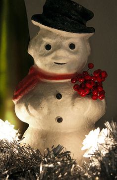 an old vintage paper-pulp bottle-warmer snowman for Kentucky Tavern Whiskey (1950s). The right arm held a printed advert in the shape of a broom, here missing, and replaced with some holly berries